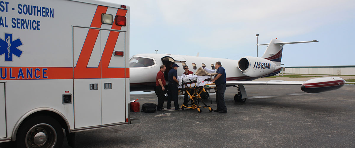 Loading A Patient From Ambulance to Aircraft